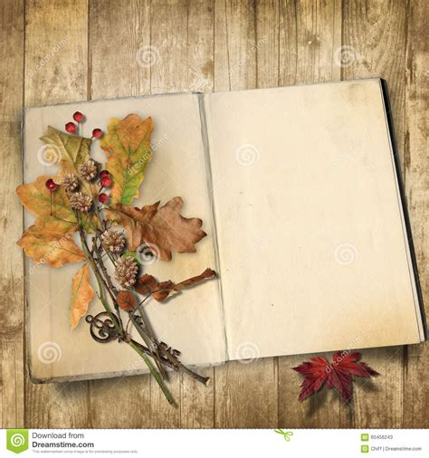 Paper For Books - autumn background book on a wooden background with