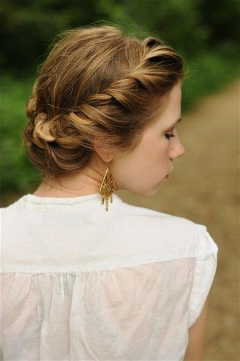 braid wrapped chignon updos cute girls hairstyles hair in two parts left side twist and coil in the