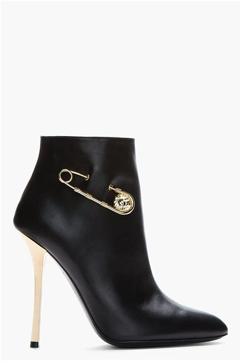 versus black leather gold trimmed army boots poshoes