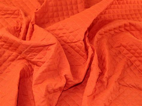 Pre Quilted Fabric By The Metre by Pre Quilted Wadding Dress Fabric Orange Fabric