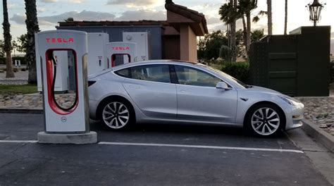 tesla charging tesla could be underselling model 3 s range and charging
