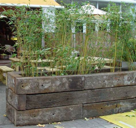 how to build a raised bed with railway sleepers garden