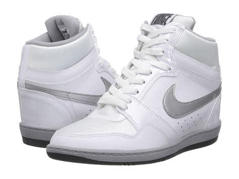 nike wedge sneakers white nike sky high sneaker wedge in white white metallic