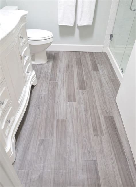 guest bath plank style floor tiles in gray sarah is it ok to put the hardwood floors in bathroom home