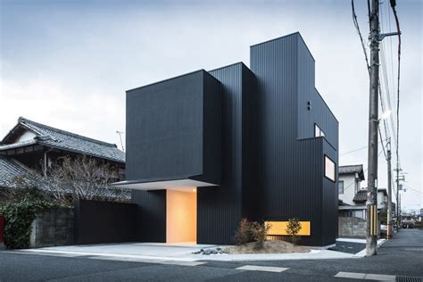 contemporary architects distinct black white exterior showcased by minimalist