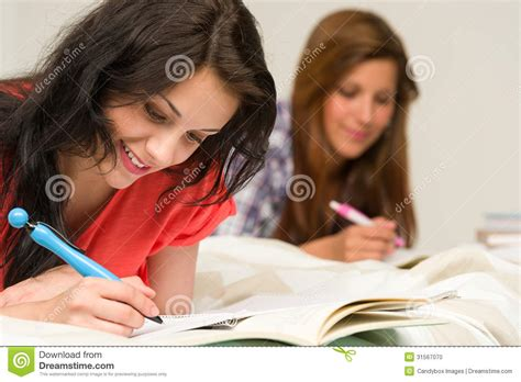 studying in bed young teenager girls studying on bed stock photo image