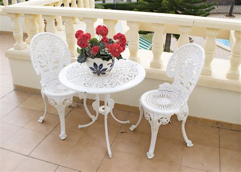 white wrought iron bistro table and chairs table and two chairs white metal for sale