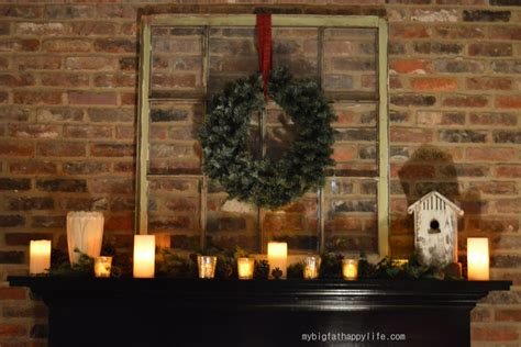 pleasant wreath hang on brick wall panelling also dark wood mantel added candles in fireplace as