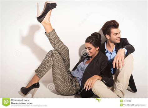 Elegant Floor Plans happy fashion couple sitting together on the floor stock