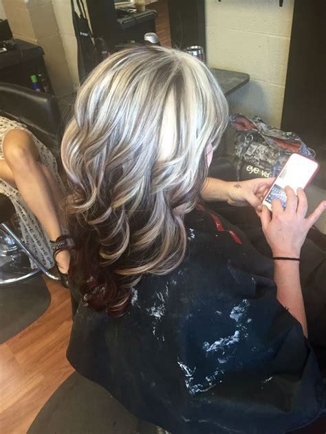 cool blonde highlights with red all underneath heavy blonde highlight with red underneath hair