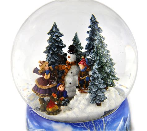 light up snow globe let it snow light up rotating musical christmas snowstorm