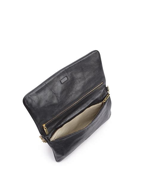 Shannon Rev Shoulder Hush Puppies burch reva convertible clutch in black lyst