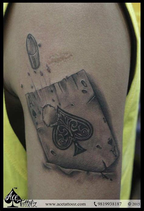 bullet passing through ace of heart tattoo design for men