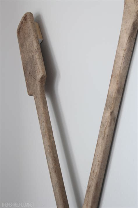 how to hang a picture on the wall how to hang oars or paddles in an x shape the inspired