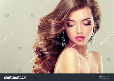 beautiful model beautiful model brunette with long curled hair and jewelry