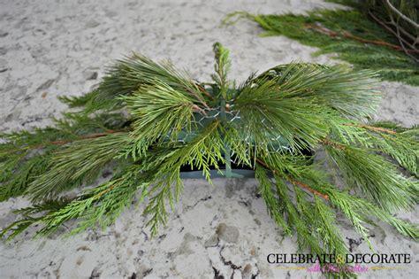 evergreen centerpieces diy evergreen centerpiece celebrate decorate