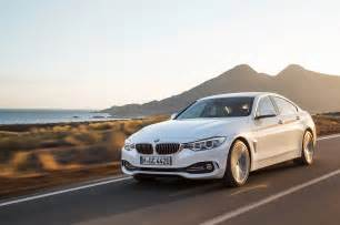 2015 bmw 435i gran coupe front three quarter in motion 09