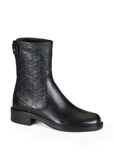 gucci gg leather ankle boots in black lyst