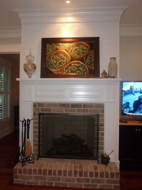 traditional brick fireplace raised hearth paneling above