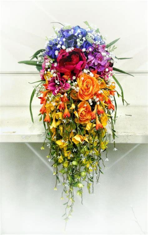 google images flower arrangements cascading rainbow bridal bouquet google search rainbow