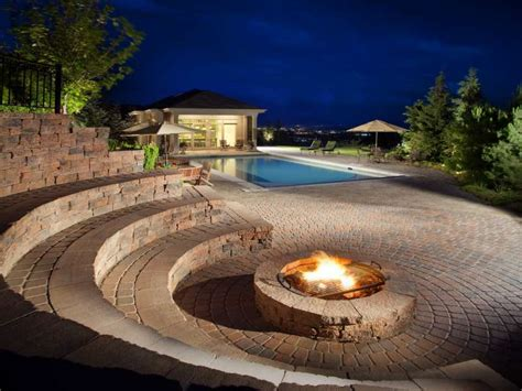 pool fire pit light up your pool area with fire features swimmingpool com