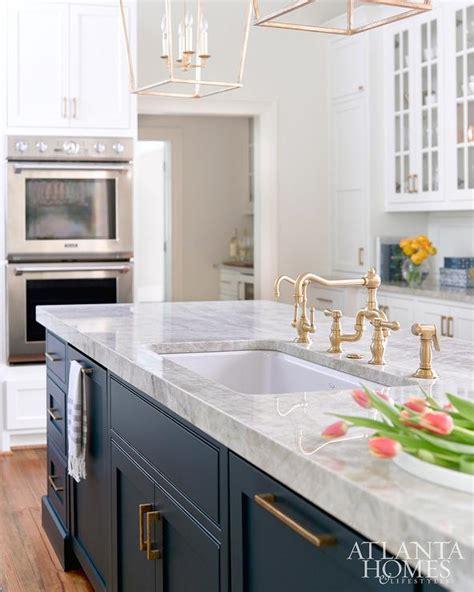 dark blue kitchen dark blue center island with brass pulls transitional