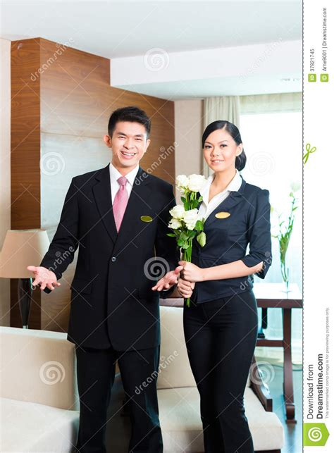welcoming guests asian chinese hotel manager welcoming vip guests stock