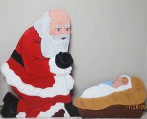 christmas santa kneeling over baby jesus wood outdoor yard