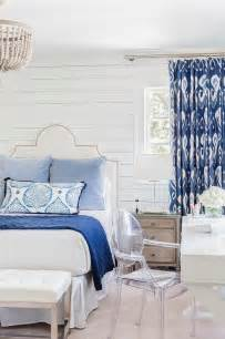 White And Blue Bedroom white and blue bedroom boasts shiplap walls lined with a white grid