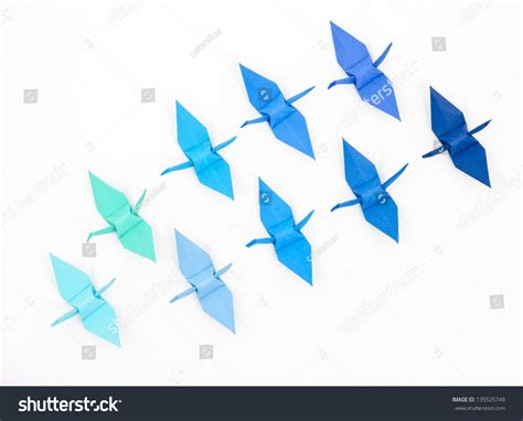 Blue Origami Paper - blue origami paper cranes on white stock photo 135525749