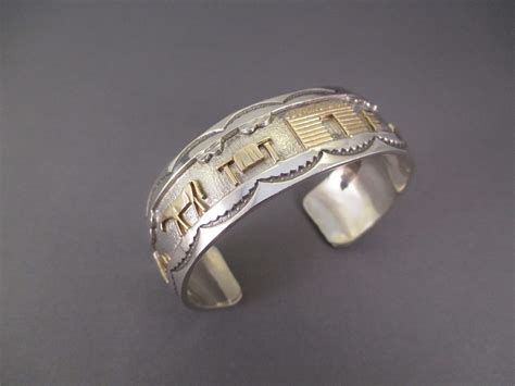 silver gold storyteller bracelet by r h begay