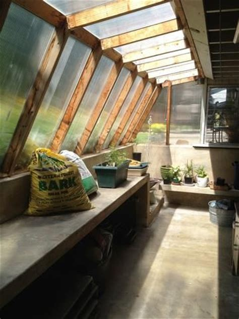 cool little greenhouse attached to house   garden