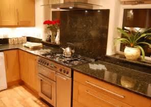 white kitchen cabinets with uba tuba granite quicua