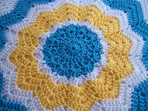 free crochet patterns for round ripple afghan crochet crocheted round ripple baby afghan in blue yellow and white