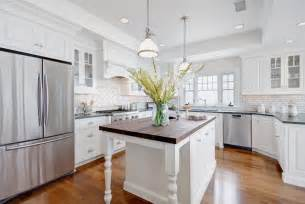 Kitchen are a dark green the center island uses a beautiful slab of