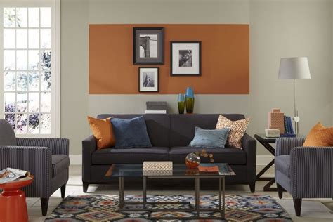 this living room features an pop of sherwin williams orange paint color reynard sw
