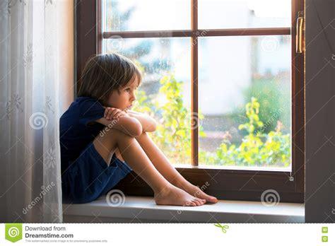 sitting window sad child boy sitting on a window shield stock image image of child bully 74854785