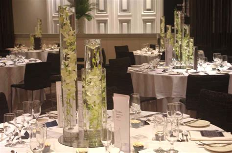 Tall Cylinder Vases Table Centrepieces Of White Orchids In Cylinder Vases
