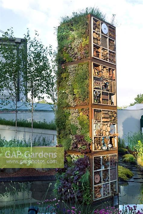 Vertical Garden Tower Gap Gardens Vertical Garden Tower With Mixed Planting Of