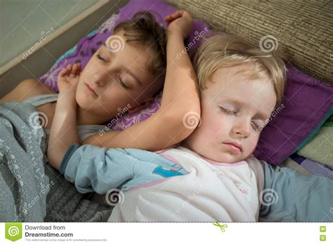 boys in bed brothers two boys sleeping together in bed stock image image of sleep sweet 69789449