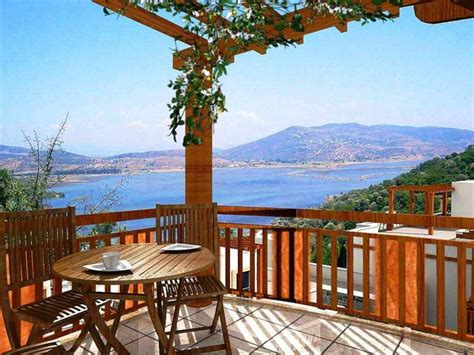Agradable  Mesas De Madera Para Jardin #10: Las-terraza-muebles-madera-ideas-vista-oceano.jpg
