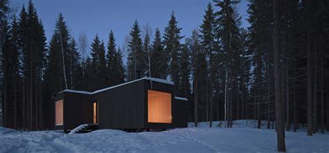 Black Exterior of Modern Wooden Villa Design in Cross like