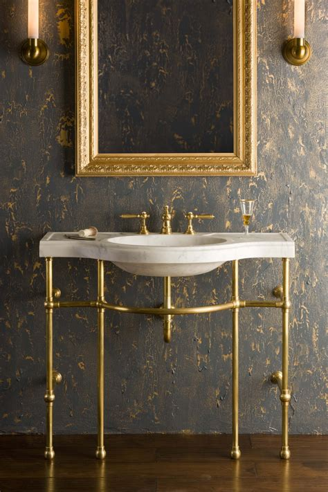 carrara marble console sink 4 leg curved console shown in brass with carrara marble