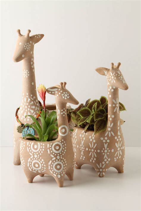 tooth shaped planter stacking giraffe pots 128 or 32 if you are lucky to