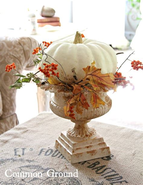 Urn Decorations by White Pumpkin In An Urn With Fall Leaves Take A Vintage