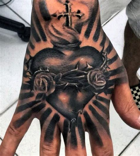 collection of 25 sacred heart hand tattoo