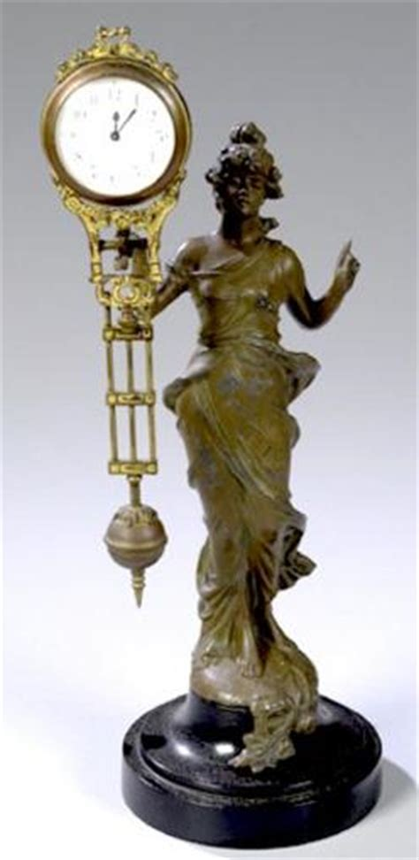 swinging clock swing arm clock junghans statue white metal wood base
