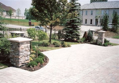 driveway entrance precast stone pavers stone columns traditional landscape toronto by