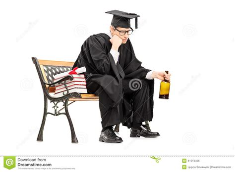 bench drinking sad college graduate drinking alcohol seated on bench stock photo image 41016456