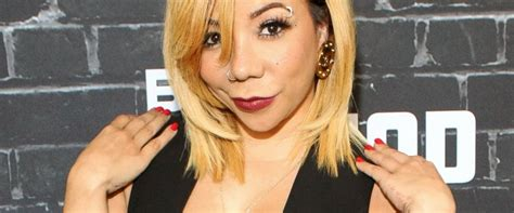 surgical eye color change tameka tiny harris gets surgical eye color change abc news
